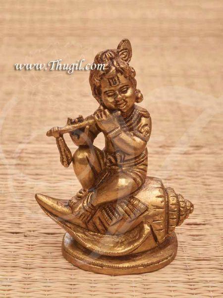 Brass baby Krishna Idol Sitting on Shankh Buy Now 4.5